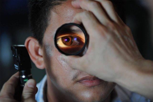 Eye doctor, man getting his eyes checked in Winnipeg, Manitoba