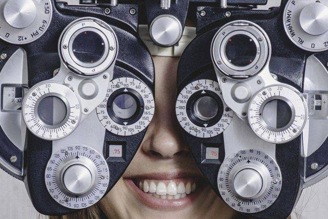 Woman enjoying eye exam in Laconia