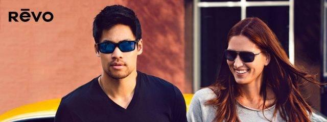 Optometrist, man & woman wearing Revo sunglasses in Oak Brook, IL