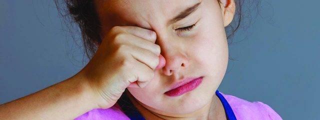 Eye doctor, little asian girl rubbing her eyes in Oak Brook, IL