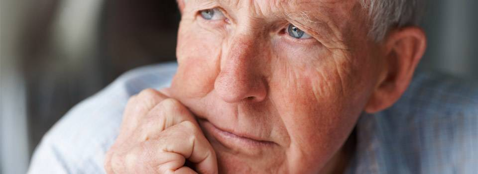 Eye doctor, pensive senior man in Oak Brook, IL