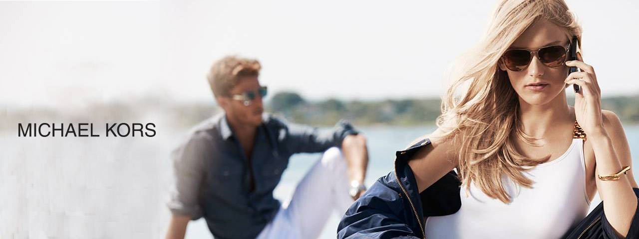 Eye doctor, man & woman wearing Michael Kors sunglasses in Carrollton, TX
