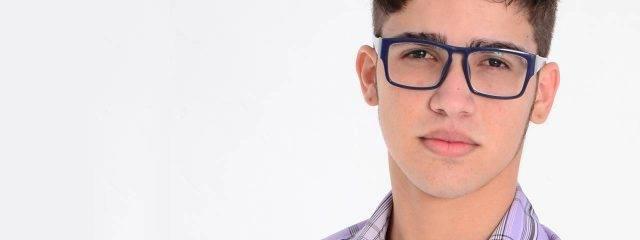 Eye doctor, teenager wearing polycarbonate lenses eyeglasses  in Carrollton, TX
