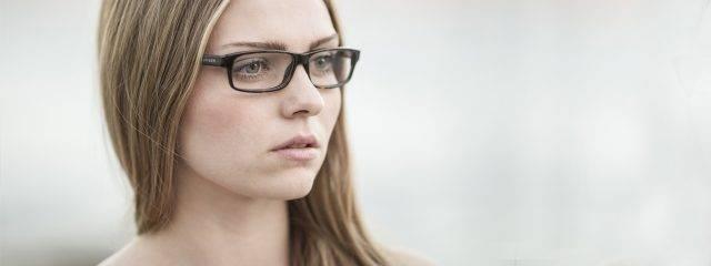 Eye doctor, woman wearing high index eyeglasses in Carrollton, TX