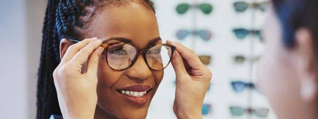 Eye doctor, African American  woman trying a new pair of eyeglasses in Carrollton, TX
