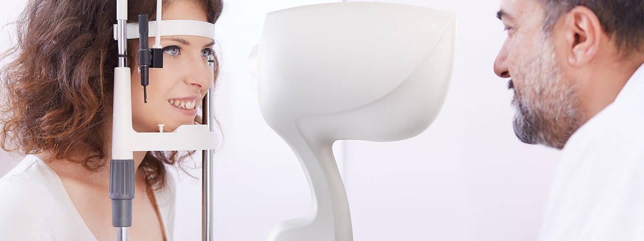 Eye Care, woman receiving eye exam in Carrollton, TX