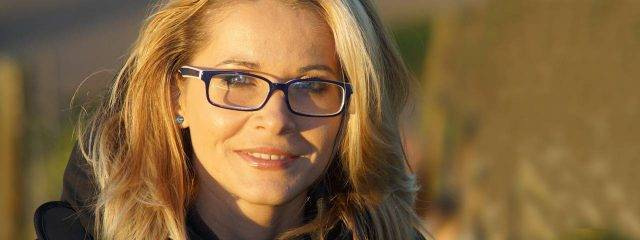 Eye care, blond woman wearing prescription eyeglasses  in Plano, TX