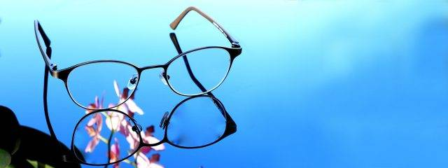 Eye care,pair of eyeglasses on a blue background in Plano, TX