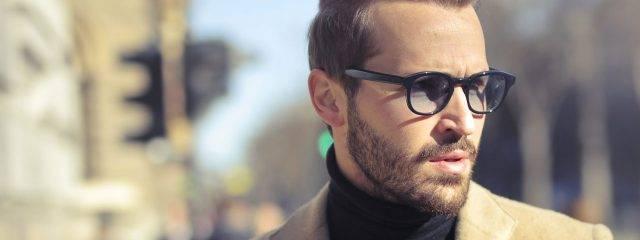 Eye care, man wearing progressive lenses eyeglasses in Plano, TX