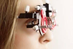 Eye doctor, woman at an eye exam in Jackson, TN