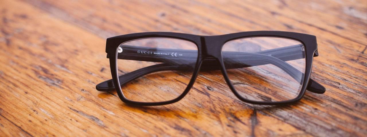 Gucci Glasses on Wood 1280×480