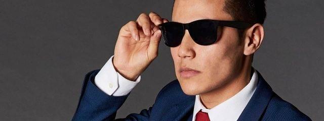 Eye doctor, asian man wearing sunglasses in Irvine & Laguna Beach, CA