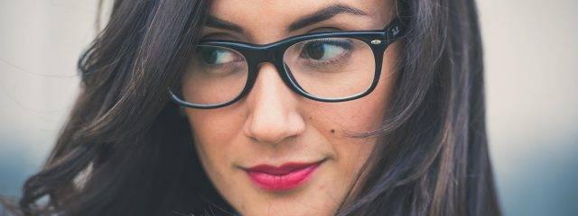 Eye doctor, woman wearing eyeglasses in Laguna Beach & Irvine, CA