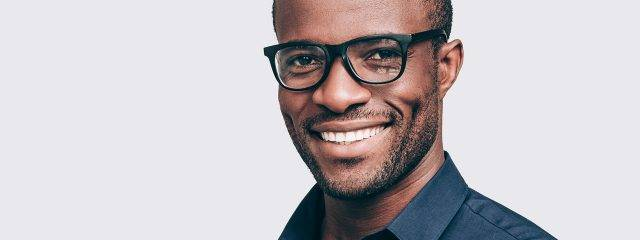 Eye doctor, african american man wearing progressive eyeglasses in Irvine & Laguna Beach, CA