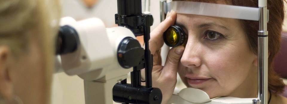 Eye care, woman at an eye exam in Concord, NC