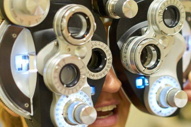Woman smiling during and eye exam
