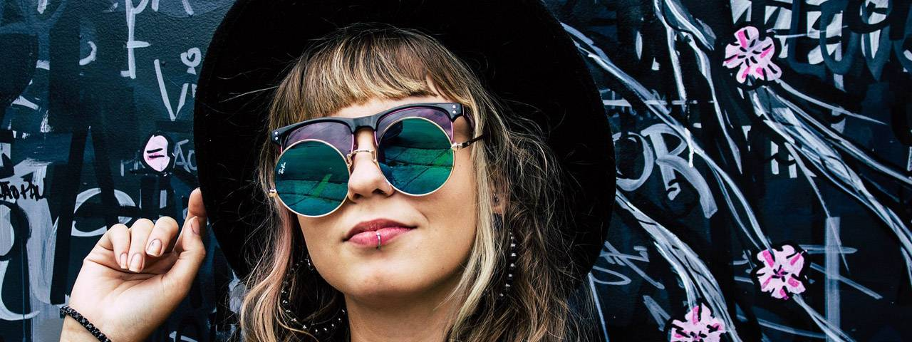 Girl wearing two pairs of sunglasses