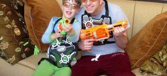 father and son playing with nerf gun while wearing special eyeglasses