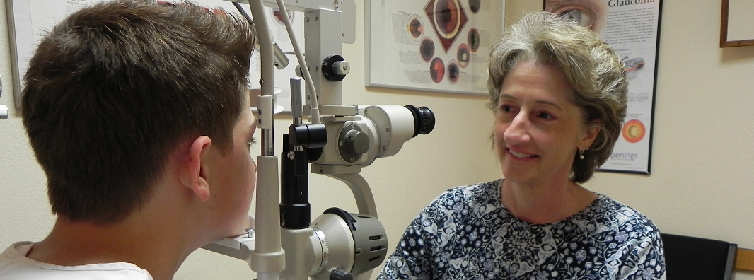 Dr. Hendrix performing an eye exam in Fayetteville