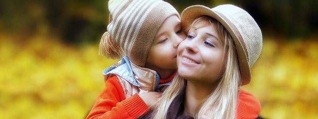 Child Kissing Mother Outdoors 1280x480 640x240