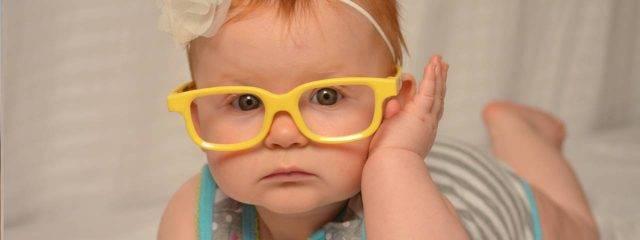 baby girl yellow glasses closeup 1280x480 640x240