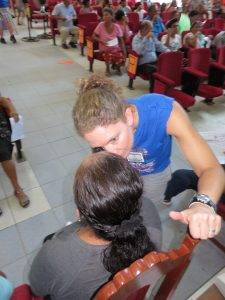 Volunteer Eye Doctor talking to a patient in Peru, Optometrist from Colorado Springs, CO