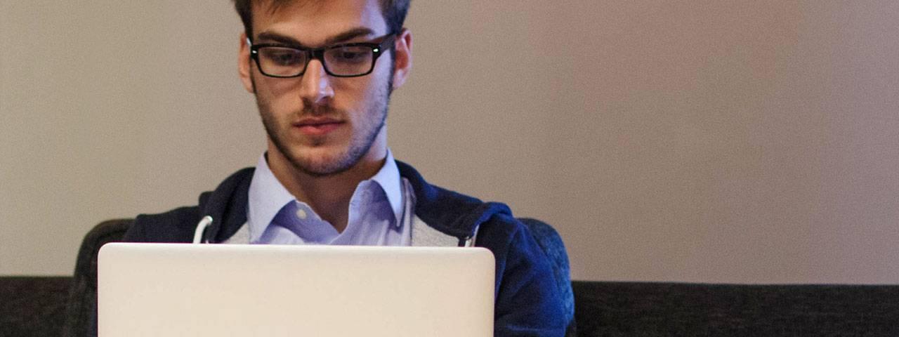 Young-Man-Using-Laptop-1280x480
