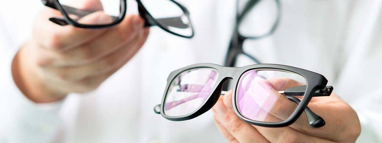 Optician Holding Glasses_1280x853 1280x480