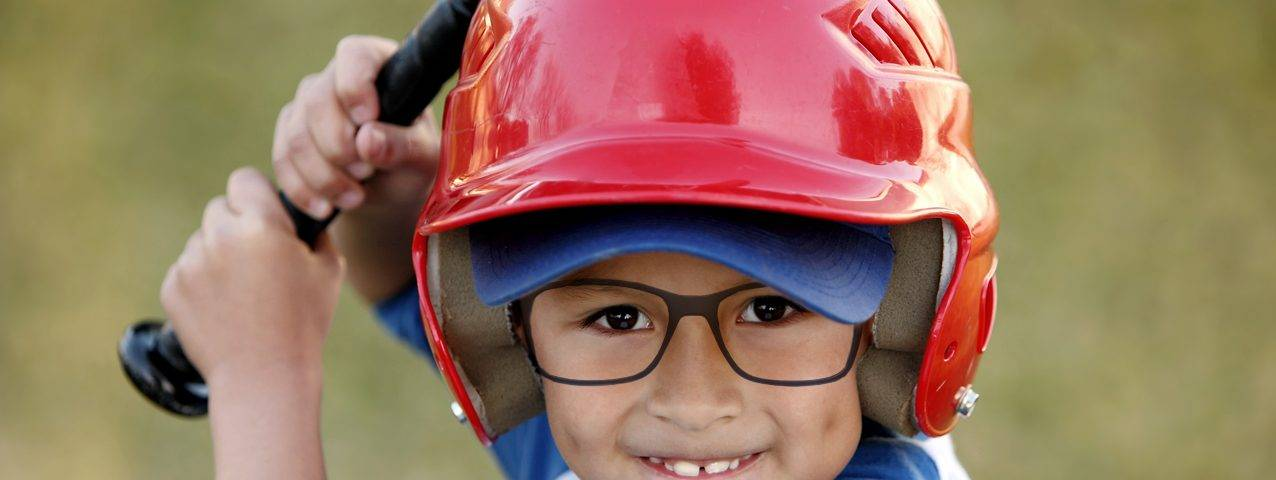 eye care, cute little boy wearing glasses, playing baseball in Fort Worth, TX