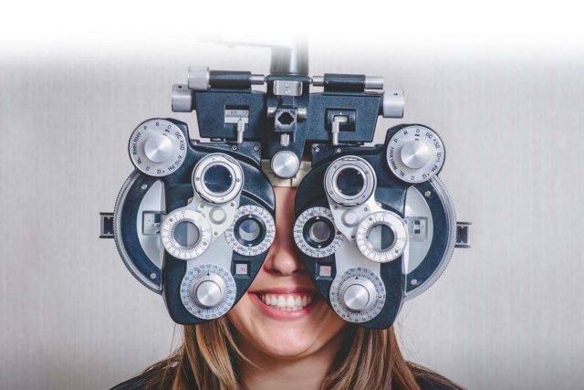 eye care, Woman enjoying eye exam in Fair Lawn, NJ
