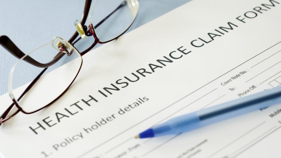 medical-health-insurance-paperwork-glasses.jpeg