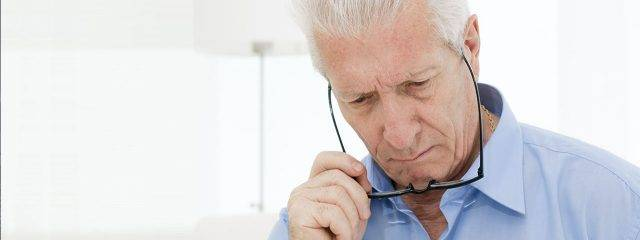 Eye doctor, senior man having difficulties reading in Myrtle Beach, SC