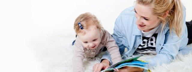 Young Mother Reading to Baby 1280x480 640x240